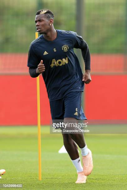 Paul Pogba of Man Utd in action during a training session ahead of their UEFA Champions League Group H match against Valencia at the Aon Training...