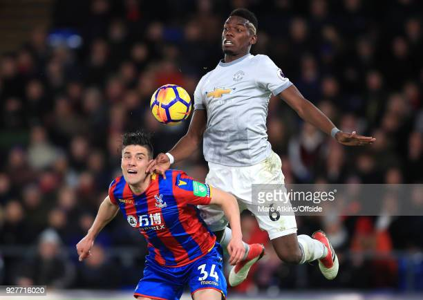 Paul Pogba of Man Utd jumps up behind Martin Kelly of Crystal Palace to chest the ball during the Premier League match between Crystal Palace and...