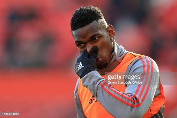 Paul Pogba of Man Utd pinches his nose during the warmup ahead of the Premier League match between Manchester United and Chelsea at Old Trafford on...