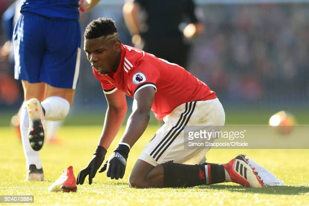 Paul Pogba of Man Utd retrieves his lost boot as Chelsea counterattack before scoring their opening goal during the Premier League match between...