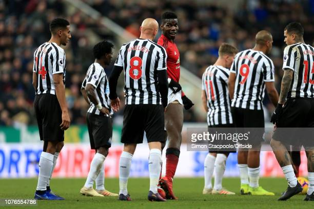 Paul Pogba of Man Utd shows his injured leg to Jonjo Shelvey of Newcastle during the Premier League match between Newcastle United and Manchester...