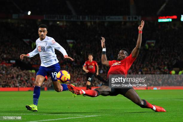 Paul Pogba of Man Utd stretches for the ball ahead of Junior Stanislas of Bournemouth during the Premier League match between Manchester United and...