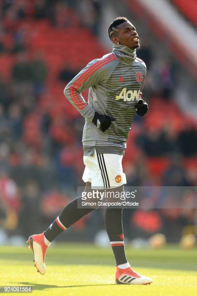 Paul Pogba of Man Utd warms up before the Premier League match between Manchester United and Chelsea at Old Trafford on February 25 2018 in...