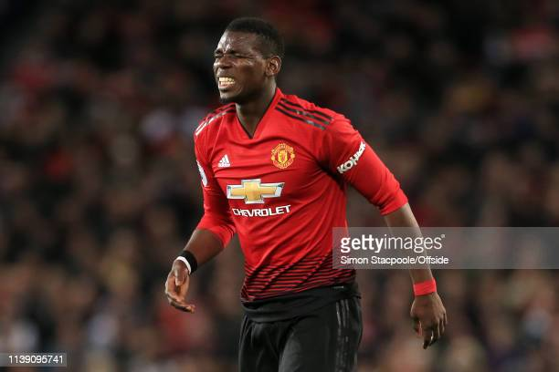 Paul Pogba of Man Utd winces in pain during the Premier League match between Manchester United and Manchester City at Old Trafford on April 24 2019...