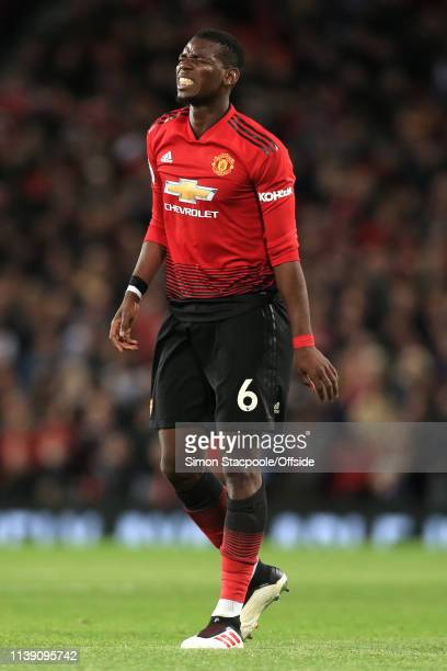 Paul Pogba of Man Utd winces in pain during the Premier League match between Manchester United and Manchester City at Old Trafford on April 24, 2019...