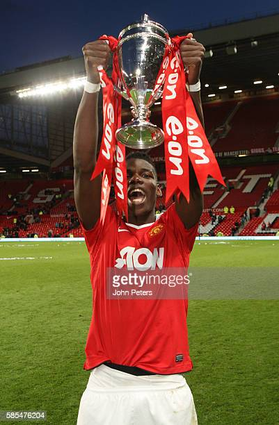 Paul Pogba of Manchester United Academy Under18s celebrate with the FA Youth Cup trophy after the FA Youth Cup Final Second Leg match between...