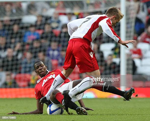 Paul Pogba of Manchester United Academy Under18s clashes with Corey Gregory of Sheffield United Academy Under18s during the FA Youth Cup Final Second...