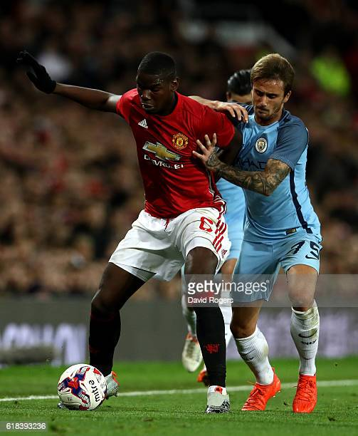Paul Pogba of Manchester United and Aleix Garcia of Manchester City battle for possession during the EFL Cup fourth round match between Manchester...