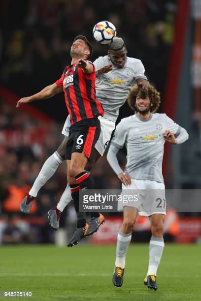 Paul Pogba of Manchester United and Andrew Surman of AFC Bournemouth battle for possession in the air during the Premier League match between AFC...