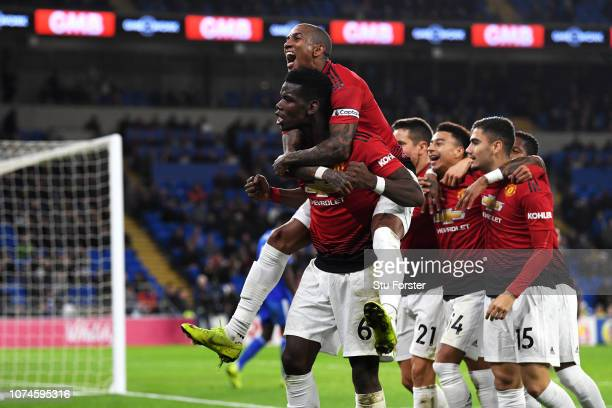 Paul Pogba of Manchester United and Ashley Young of Manchester United celebrate as teammate Jesse Lingard scores their team's fifth goal during the...