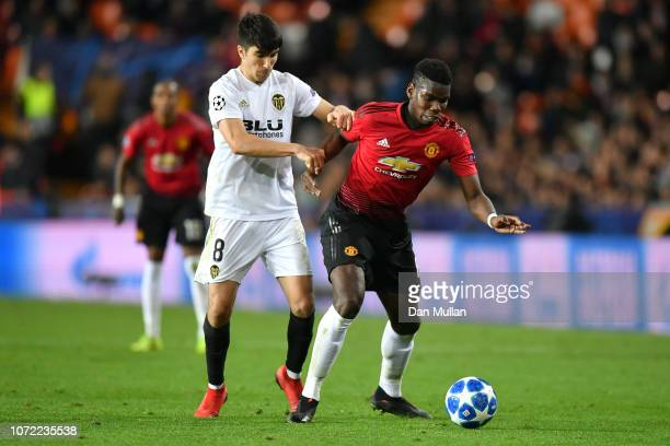 Paul Pogba of Manchester United and Carlos Soler of Valencia in action during the UEFA Champions League Group H match between Valencia and Manchester...