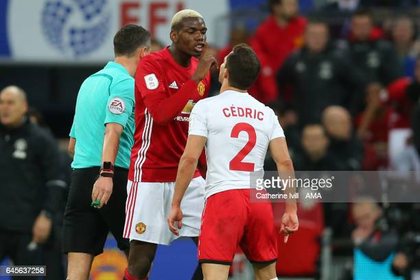 Paul Pogba of Manchester United and Cedric Soares of Southampton during the EFL Cup Final match between Manchester United and Southampton at Wembley...