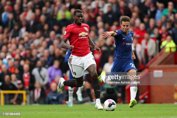 Paul Pogba of Manchester United and Cesar Azpilicueta of Chelsea during the Premier League match between Manchester United and Chelsea FC at Old...