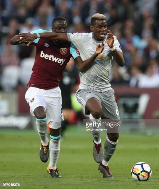 Paul Pogba of Manchester United and Cheikhou Kouyate of West Ham United battle for possession during the Premier League match between West Ham United...