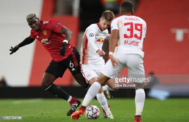 Paul Pogba of Manchester United and Dani Olmo of RB Leipzig battle for the ball during the UEFA Champions League Group H stage match between...