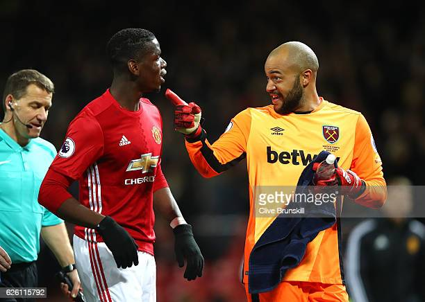 Paul Pogba of Manchester United and Darren Randolph of West Ham United exchange words while walking in at half time during the Premier League match...
