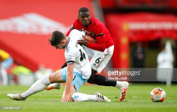 Paul Pogba of Manchester United and Declan Rice of West Ham United battle for the ball during the Premier League match between Manchester United and...