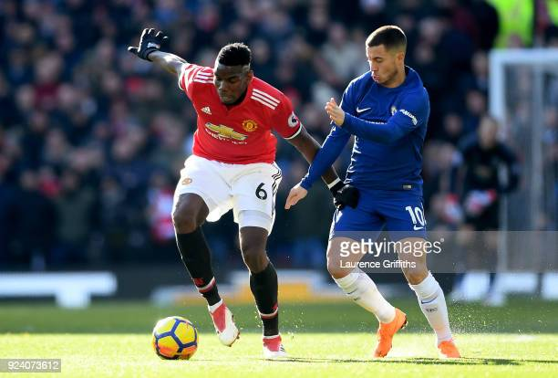 Paul Pogba of Manchester United and Eden Hazard of Chelsea in action during the Premier League match between Manchester United and Chelsea at Old...
