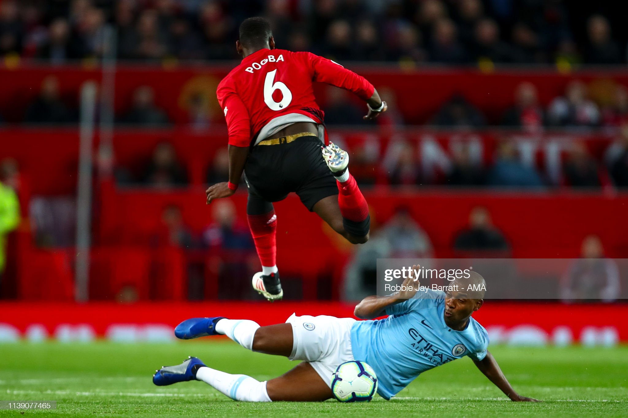 https://media.gettyimages.com/photos/paul-pogba-of-manchester-united-and-fernandinho-of-manchester-city-picture-id1139077465?s=2048x2048
