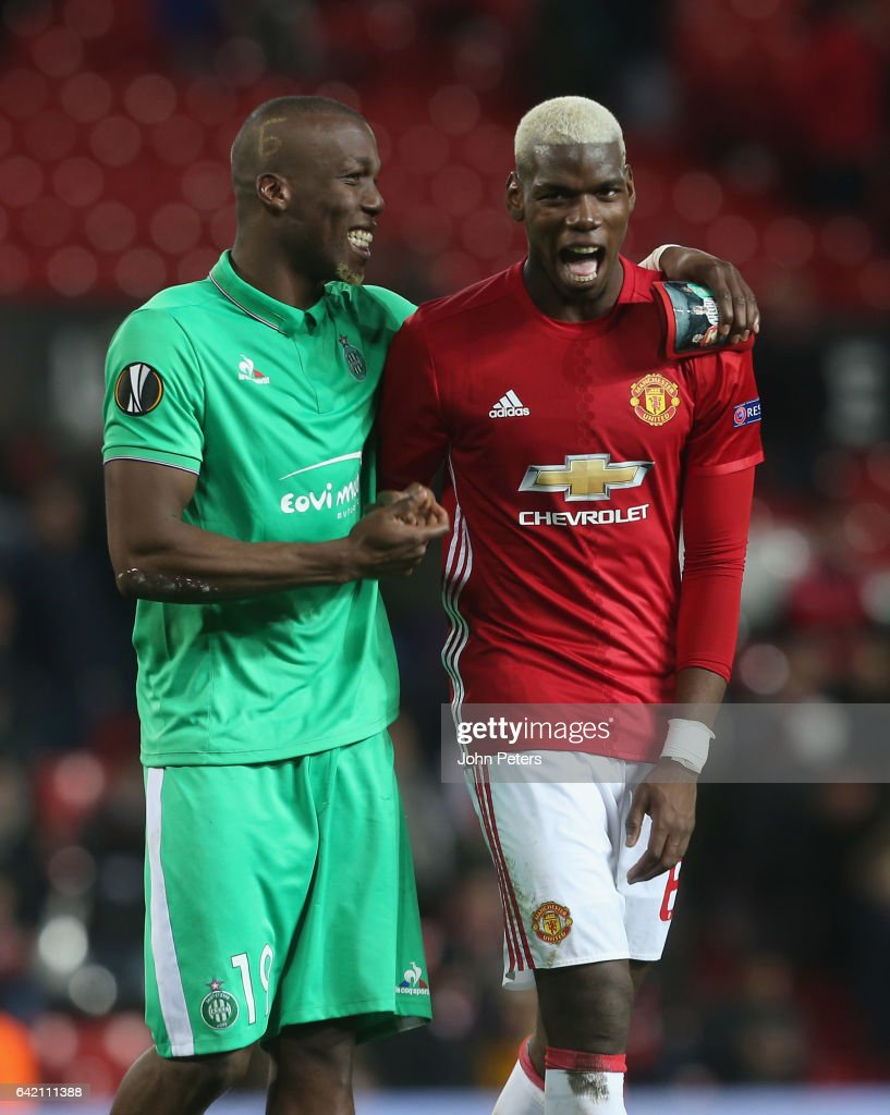 Paul Pogba of Manchester United and Florentin Pogba of AS Saint-Etienne walks off after the UEFA Europa League Round of 32 first leg match between Manchester United and AS Saint-Etienne at Old Trafford on February 16, 2017 in Manchester, United Kingdom.