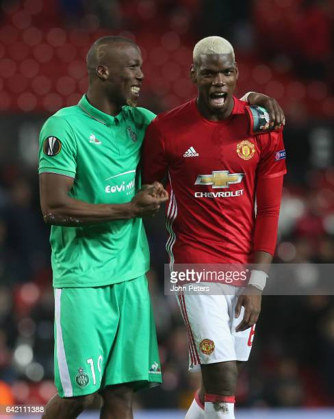Paul Pogba of Manchester United and Florentin Pogba of AS Saint-Etienne walks off after the UEFA Europa League Round of 32 first leg match between...