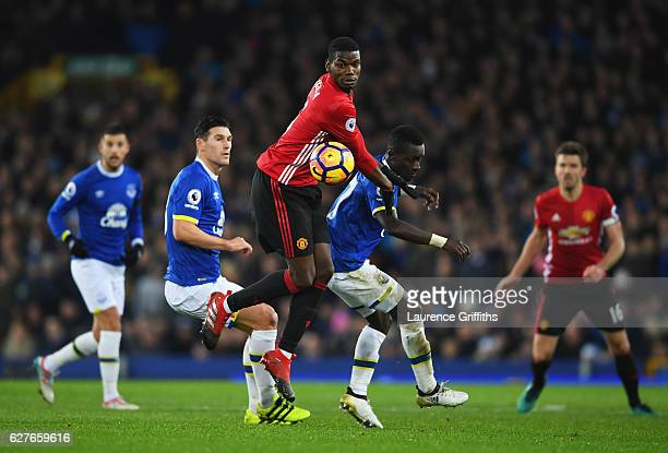 Paul Pogba of Manchester United and Idrissa Gueye of Everton battle for the ball during the Premier League match between Everton and Manchester...