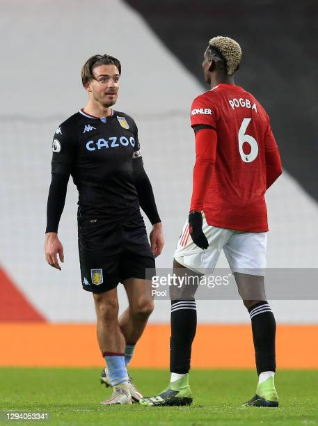 Paul Pogba of Manchester United and Jack Grealish of Aston Villa talk following the Premier League match between Manchester United and Aston Villa at...