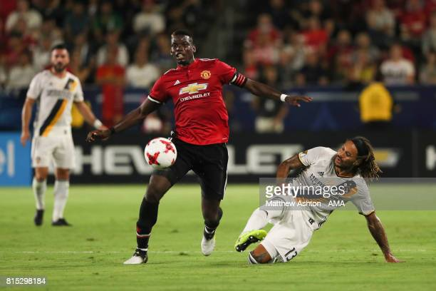 Paul Pogba of Manchester United and Jermaine Jones of LA Galaxy during to the friendly fixture between LA Galaxy and Manchester United at StubHub...