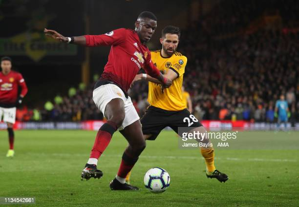 Paul Pogba of Manchester United and Joao Moutinho of Wolverhampton Wanderers during the Premier League match between Wolverhampton Wanderers and...