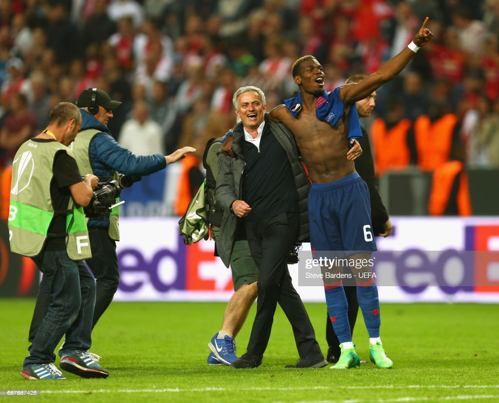 Paul Pogba of Manchester United and Jose Mourinho, Manager of Manchester United celebrate together after the UEFA Europa League Final between Ajax and Manchester United at Friends Arena on May 24, 2017 in Stockholm, Sweden.