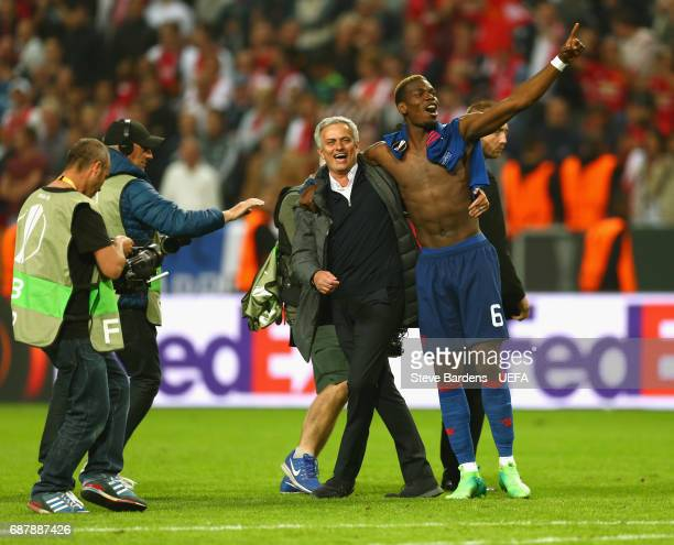 Paul Pogba of Manchester United and Jose Mourinho Manager of Manchester United celebrate together after the UEFA Europa League Final between Ajax and...