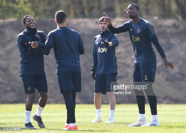 Paul Pogba of Manchester United and Juan Mata of Manchester United speak to Marcos Rojo of Manchester United and Fred of Manchester United during the...