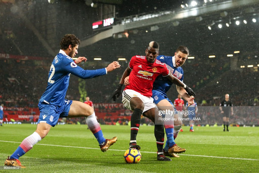 Paul Pogba of Manchester United and Kevin Wimmer of Stoke City during the Premier League match between Manchester United and Stoke City at Old Trafford on January 15, 2018 in Manchester, England.
