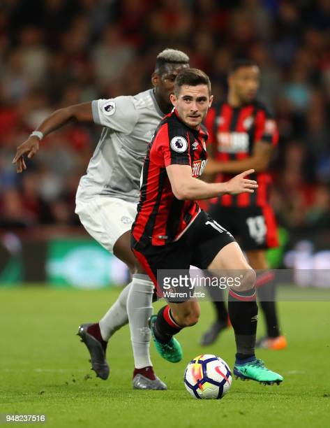 Paul Pogba of Manchester United and Lewis Cook of AFC Bournemouth battle for possession during the Premier League match between AFC Bournemouth and...