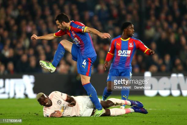 Paul Pogba of Manchester United and Luka Milivojevic of Crystal Palace in action during the Premier League match between Crystal Palace and...