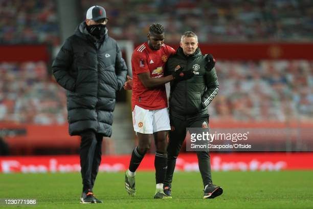 Paul Pogba of Manchester United and Manchester United manager Ole Gunnar Solskjaer celebrate after their victory as Liverpool manager Jurgen Klopp...