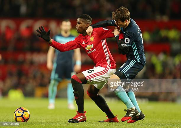 Paul Pogba of Manchester United and Marten de Roon of Middlesbrough during the Premier League match between Manchester United and Middlesbrough at...
