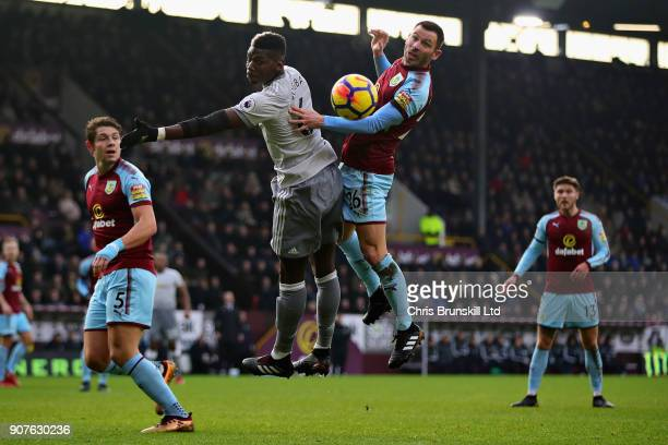 Paul Pogba of Manchester United and Phil Bardsley of Burnley jump for a header during the Premier League match between Burnley and Manchester United...