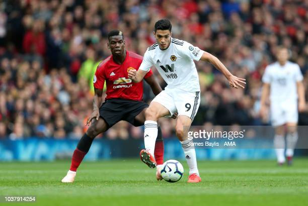 Paul Pogba of Manchester United and Raul Jimenez of Wolverhampton Wanderers during the Premier League match between Manchester United and...