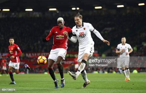 Paul Pogba of Manchester United and Sebastian Prodl of Watford compete for the ball during the Premier League match between Manchester United and...