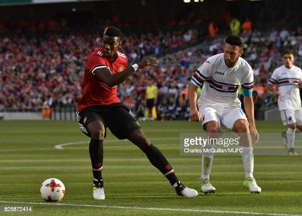 Paul Pogba of Manchester United and Vasco Regini of Sampdoria during the Aon Tour pre season friendly game between Manchester United and Sampdoria at...