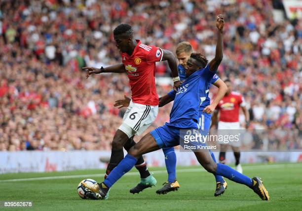 Paul Pogba of Manchester United and Wilfred Ndidi of Leicester City battle for possession during the Premier League match between Manchester United...