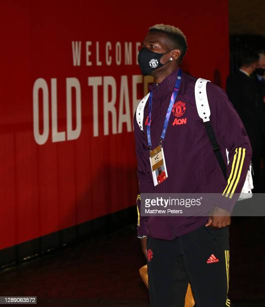 Paul Pogba of Manchester United arrives ahead of the UEFA Champions League Group H stage match between Manchester United and Paris Saint-Germain at...