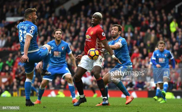 Paul Pogba of Manchester United attempts to control the ball while under pressure from Steve Cook of AFC Bournemouth during the Premier League match...