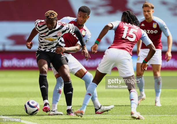 Paul Pogba of Manchester United battles for possession with Ezri Konsa of Aston Villa during the Premier League match between Aston Villa and...