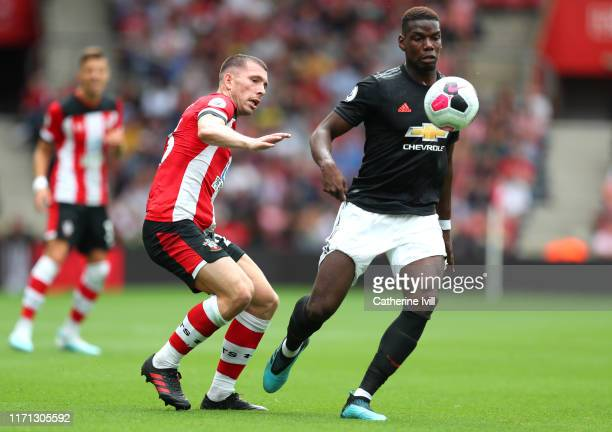 Paul Pogba of Manchester United battles for possession with PierreEmile Hojbjerg of Southampton during the Premier League match between Southampton...