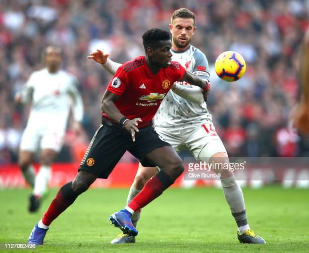 Paul Pogba of Manchester United battles for possession with Jordan Henderson of Liverpool during the Premier League match between Manchester United...