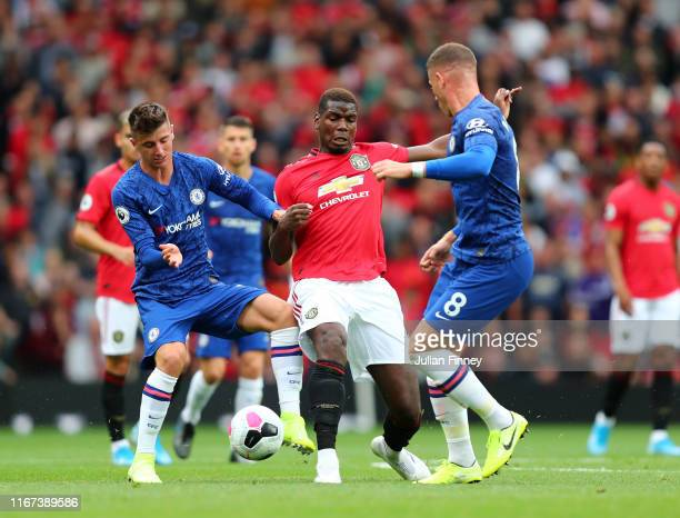 Paul Pogba of Manchester United battles for possession with Mason Mount and Ross Barkley of Chelsea during the Premier League match between...