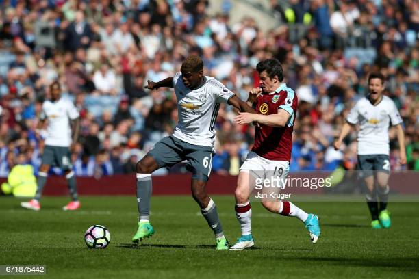 Paul Pogba of Manchester United battles for the ball with Joey Barton of Burnley during the Premier League match between Burnley and Manchester...