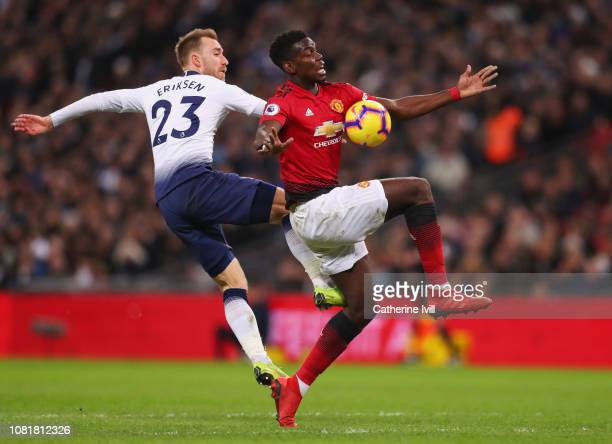 Paul Pogba of Manchester United battles with Christian Eriksen of Tottenham Hotspur during the Premier League match between Tottenham Hotspur and...